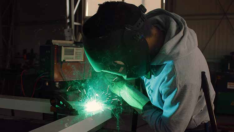Professional welder working